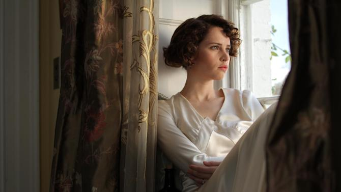 """This film image released by IFC Films shows Felicity Jones as Dolly Thatchum in a scene from """"Cheerful Weather for the Wedding."""" (AP Photo/IFC Films, Julian White )"""