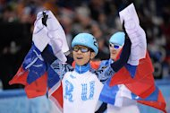 Russia's Victor An celebrates his team victory after the Men's Short Track 5000m Relay Final at the Iceberg Skating Palace during the Sochi Winter Olympics on February 21, 2014