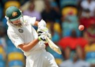 Australian cricketer Nathan Lyon plays a shot in April 2012. South Africa won the toss and chose to bat on the opening day of the first cricket Test against Australia at the Gabba on Friday