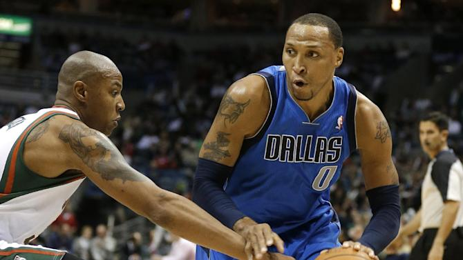 Dallas Mavericks' Shawn Marion, right, drives against Milwaukee Bucks' Caron Butler during the first half of an NBA basketball game Saturday, Nov. 9, 2013, in Milwaukee
