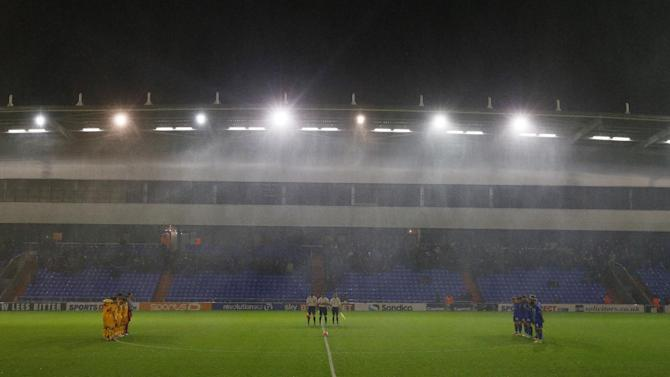 Mansfield Town and Oldham Athletic players during a minute's silence in memory of the Paris attacks before the match