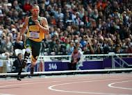 South Africa's Oscar Pistorius competes in the men's 400m heats at the London 2012 Olympic Games on August 4, 2012. A sobbing Pistorius was formally charged by a South African magistrate with murdering his model girlfriend on Valentine's Day
