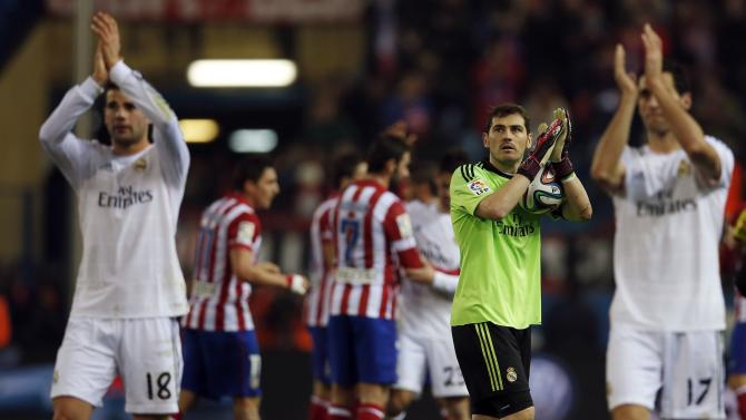 Real Madrid's Casillas, Fernandez and Arbeloa clap after winning their Spanish King's Cup semi-final second leg soccer match against Atletico Madrid in Madrid