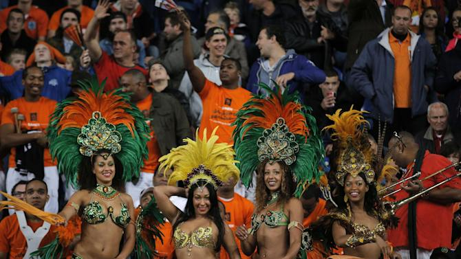 Soocer fans, some already taking a head start on the 2014 Brazil World Cup, watch The Netherlands beat Hungary with a 8-1 score during the Group D World Cup qualifying soccer match at ArenA stadium in Amsterdam, Netherlands, Friday Oct. 11, 2013
