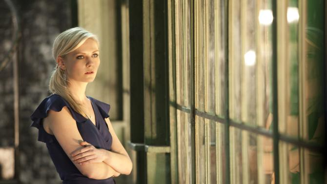 """This publicity film image released by Millennium Entertainment shows Kirsten Dunst in a scene from """"Upside Down."""" (AP Photo/Millennium Entertainment, Takashi Seida)"""