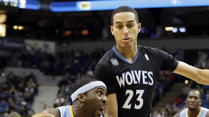 Denver Nuggets' Ty Lawson, left, drives around Minnesota Timberwolves' Kevin Martin in the second half of an NBA basketball game on Wednesday, Nov. 27, 2013, in Minneapolis. Lawson led the Nuggets with 23 points while Martin led the Timberwolves with 29 points. The Nuggets won 117-110