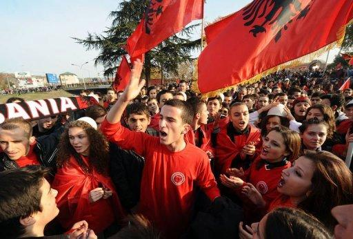 """Young Albanians parade and wave flags on the streets of Skopje, Macedonia, as they celebrate the upcoming centenary of Albania's independence from the Ottoman empire. The leaders of Albania and Kosovo vowed to achieve unity for ethnic Albanians in the region during celebration of Albania's independence in the Macedonian capital Sunday but said it should be """"within EU boundaries""""."""