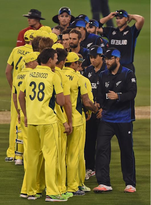New Zealand's Daniel Vettori leads teammates as they shake hands with Australian cricketers at the end of the ICC Cricket World Cup final in Melbourne, Australia, Sunday, March 29, 2015. (AP Photo/And