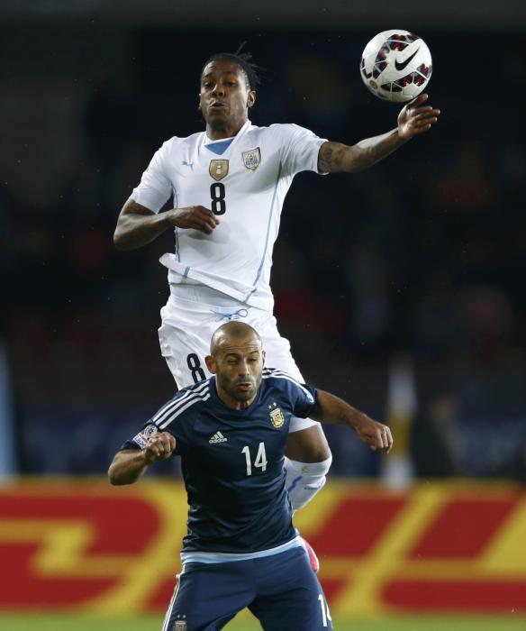 Uruguay's Hernandez jumps for the ball over Argentina's Mascherano during their first round Copa America 2015 soccer match at Estadio La...