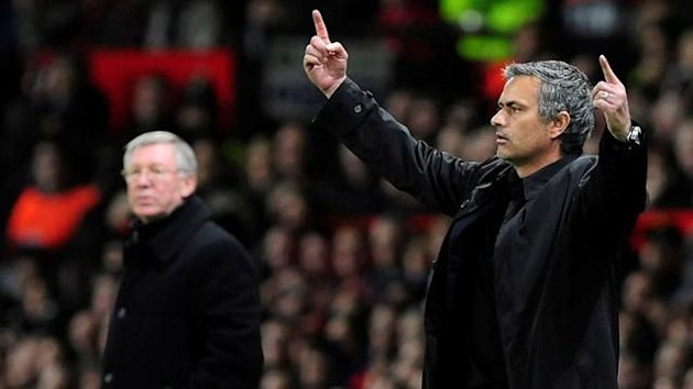Jose Mourinho (R) gestures next to Manchester United manager Sir Alex Ferguson (Reuters)