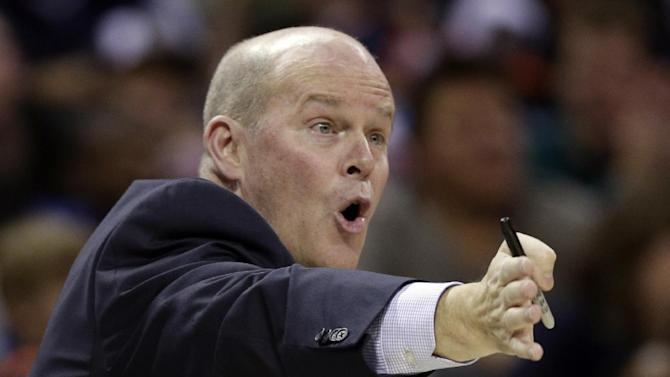 Charlotte Bobcats coach Steve Clifford talks to his players during the second half of an NBA basketball game against the Miami Heat in Charlotte, N.C., Saturday, Nov. 16, 2013. Miami won 97-81