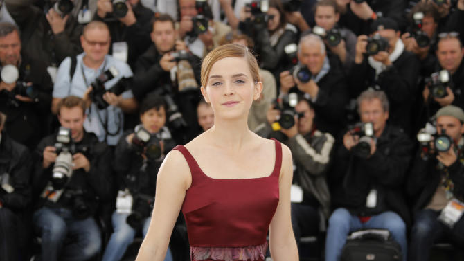 Actor Emma Watson poses for photographers during a photo call for the film The Bling Ring at the 66th international film festival, in Cannes, southern France, Thursday, May 16, 2013. (AP Photo/Francois Mori)