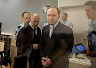 In this picture taken through bullet-proof glass, mass killer Anders Behring Breivik arrives for his trial in room 250 of Oslo's central court on Thursday. Breivik, who killed 77 people in Norway last July, should be locked up in a psychiatric ward instead of prison, the prosecution said Thursday, arguing his sanity had not been proven beyond a reasonable doubt