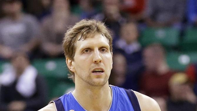 Dallas Mavericks' Dirk Nowitzki (41) pumps his fist after scoring against the Utah Jazz in the second half during an NBA basketball game Wednesday, March 12, 2014, in Salt Lake City. The Mavericks won 108-101