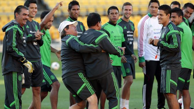 Mexico's coach Herrera jokes around during a training session for their 2014 World Cup qualifying playoff second leg soccer match against New Zealand in Wellington