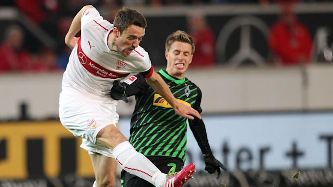 Stuttgart's Christian Gentner, left, and Moenchengladbach's Patrick Herrmann challenge for the ball during the German first division Bundesliga soccer match between VfB Stuttgart and Borussia Moenchengladbach Stuttgart, Germany, Friday, Nov. 22, 2013