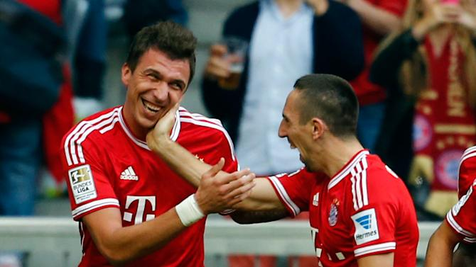 Mandzukic of FC Bayern Munich celebrates during their German first division Bundesliga soccer match against Hertha Berlin in Munich