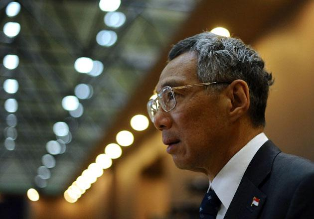 Prime Minister Lee Hsien Loong urges people to be careful online. (AFP photo)