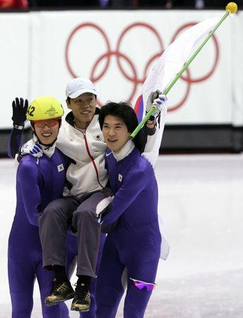 Seo Ho-Jin (242) and Oh Se-Jong (R) of South Korea carry their coach Song Jae-Kenn after the men's 5..