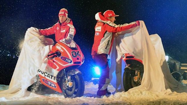 Ducati riders Nicky Hayden (R) and Andrea Dovizioso unveil their Ducati motorbikes during the Wrooom, F1 and MotoGP Press Ski Meeting, Ducati and Ferrari's annual media gathering, in Italy.