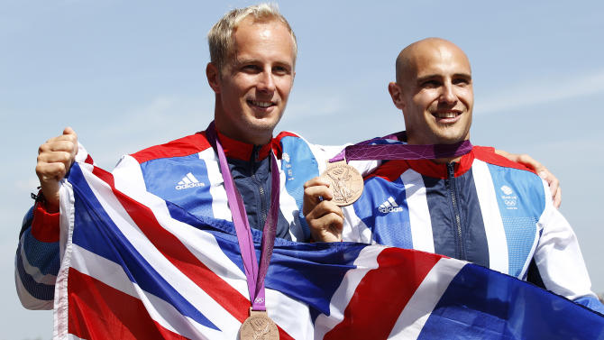 Bronze medallists Britain's Liam Heath and Jon Schofield stand on the podium during the victory ceremony for the men's kayak double (K2) 200m final at the Eton Dorney during the London 2012 Olympic Games