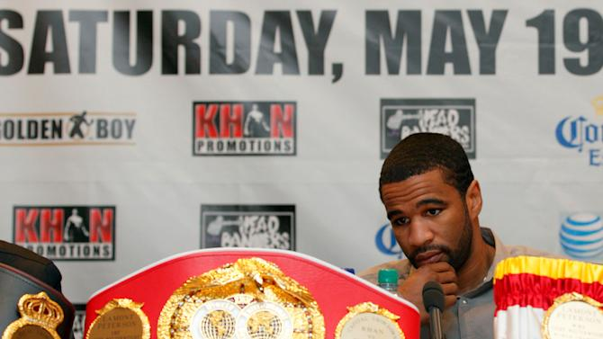 US boxer Lamont Peterson addresses a press conference with British boxer Amir Khan (not pictured) in London, on March 13, 2012. Amir Khan on Tuesday vowed to learn from his mistakes when he faces American Lamont Peterson in their keenly anticipated world title rematch in May. Khan cried foul after losing a split decision to Peterson in their see-saw battle for the WBA and IBF lightwelterweight titles in Washington in December, insisting he had been the victim of dubious scoring. AFP PHOTO/JUSTIN TALLIS (Photo credit should read JUSTIN TALLIS/AFP/Getty Images)
