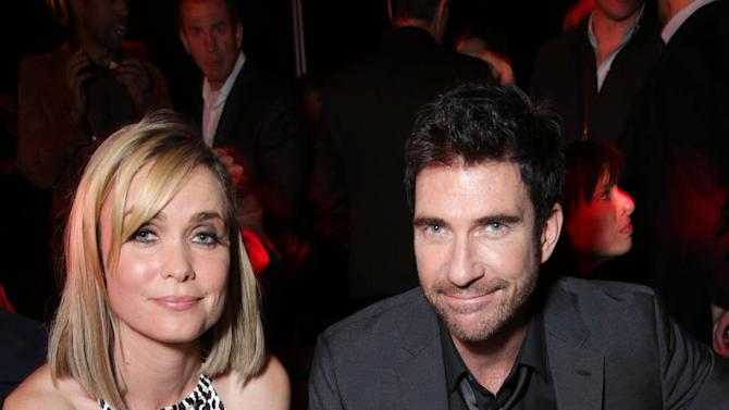 Radha Mitchell and Dylan McDermott  at FilmDistrict's Premiere of 'Olympus Has Fallen' hosted by Brioni and Grey Goose at the ArcLight Hollywood, on Monday, March, 18, 2013 in Los Angeles. (Photo by Eric Charbonneau/Invision for FilmDistrict/AP Images)