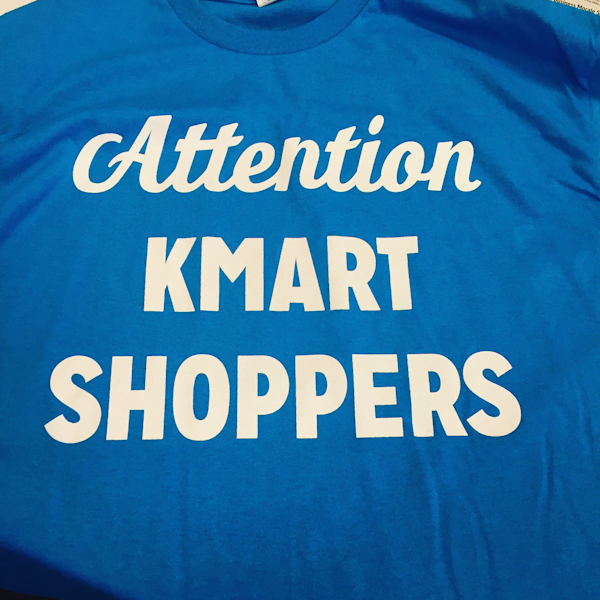 Attention kmart shoppers retailer pokes fun at itself in for Kmart shirts for employees