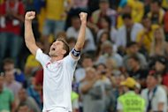 English midfielder Steven Gerrard celebrates after the Euro 2012 football championships match England vs Ukraine at the Donbass Arena in Donetsk. England scraped into the quarter-finals of Euro 2012 here Tuesday after a goal-line refereeing blunder helped them to a 1-0 win over Ukraine which sent the co-hosts crashing out