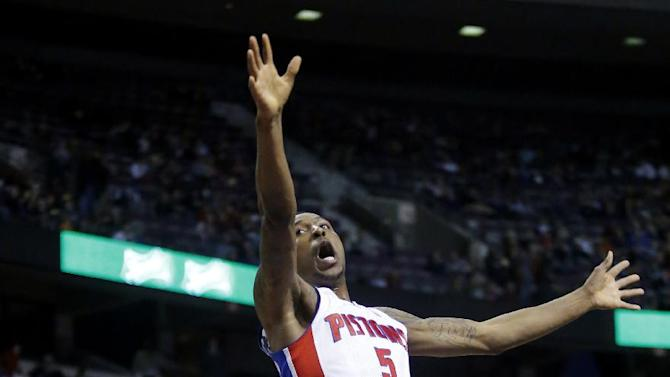 Detroit Pistons guard Kentavious Caldwell-Pope (5) reacts after being fouled by Philadelphia 76ers forward Hollis Thompson (31) while going to the basket during the second half of an NBA basketball game, Saturday, Feb. 1, 2014, in Auburn Hills, Mich. The Pistons won 113-96