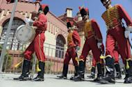 Members of the Honor Guard parade in front of the Mountain Barracks (Cuartel de la Montana) where the remains of late Venezuelan President Hugo Chavez are staying, in the 23 de Enero low income neighborhood in Caracas, on March 28, 2013