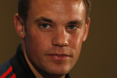 Bayern Munich's Neuer attends a news conference at Old Trafford in Manchester