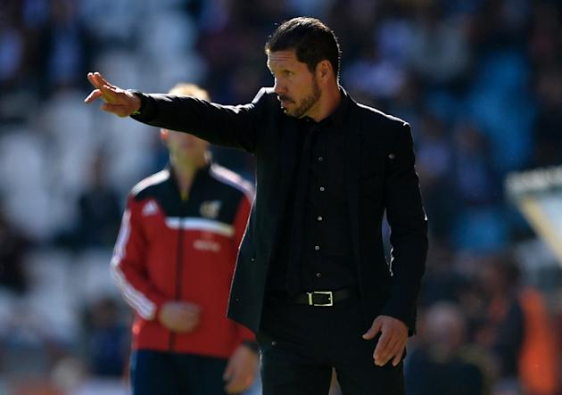 Atletico Madrid coach Diego Simeone on the sidelines during his side's Spanish league match against Deportivo in La Coruna on April 18, 2015