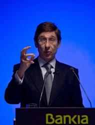 The new president of Spain's fourth-biggest bank, Bankia, Jose Ignacio Goirigolzarri speaks during a press conference in Madrid. Goirigolzarri said he was confident of receiving from the government 19 billion euros ($24 billion) in the largest bank bailout in the country's history