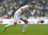 Mesut Ozil eyes the ball during a Spanish league match against Real Betis at the Santiago Bernabeu stadium in Madrid on August 18, 2013. Arsenal's record signing Ozil expressed confidence that he can hit the ground running at the Emirates Stadium and help the club end their eight-year trophy drought
