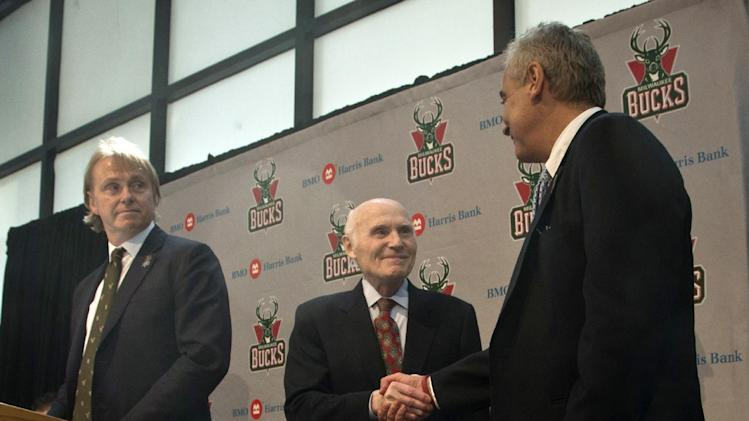 Milwaukee Bucks owner Herb Kohl, center, shakes hands with investment firm executives  Wesley Edens, right, and Marc Lasry,  at a news conference after reaching a deal to sell the franchise Wednesday, April 16, 2014, in Milwaukee. The deal is subject to approval by the NBA and its Board of Governors