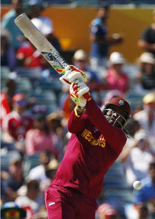 West Indies batsman Chris Gayle swings and misses the ball during his Cricket World Cup match against India in Perth