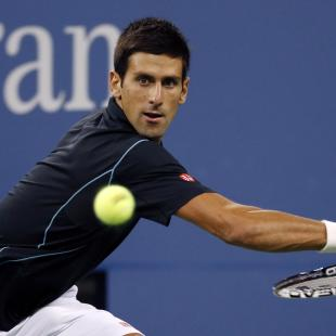 Djokovic breezes past Youzhny into semis