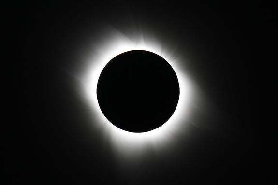 This view of the sun's extremely hot outer atmosphere, called the corona, was captured by Edwin Aguirre and Imelda Joson from the South Pacific during the total solar eclipse on July 11, 2010. Note the moon's pitch-black silhouette and the coro