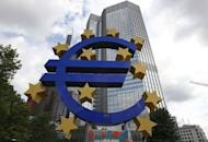 "A giant logo of the Euro currency stands in front of the European Central Bank. European Central Bank head Mario Draghi insisted Thursday the embattled euro was ""irreversible"" but markets sold off sharply on disappointment he announced no immediate measures to tame the debt crisis"