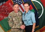David Petraeus shakes hands with his biographer Paula Broadwell in Afghanistan in this 2011 image provide by International Security Assistance Force NATO. The FBI uncovered the affair that led to the resignation of Petraeus while investigating threatening emails sent by his lover to a second woman, US media reported Sunday