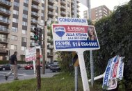 For sale signs stand in front of a condo September 27, 2011 in Montreal. THE CANADIAN PRESS/Ryan Remiorz