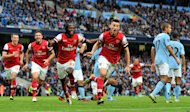 Laurent Koscielny, right, celebrates scoring Arsenal's equaliser