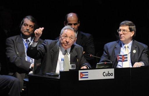 In a picture released by the Chilean Presidency, Cuban President Raul Castro (L) delivers a speech as his Foreign Minister Bruno Rodriguez looks on at the Latin American and Caribbean States (CELAC) Summit in Santiago, on January 28, 2013.