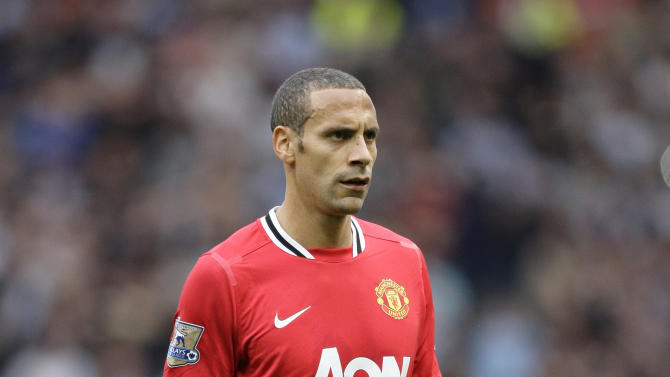 Manchester United's Rio Ferdinand walks from the pitch after his team's 6-1 loss to Manchester City in their English Premier League soccer match at Old Trafford Stadium, Manchester, England, Sunday Oct. 23, 2011. (AP Photo/Jon Super)