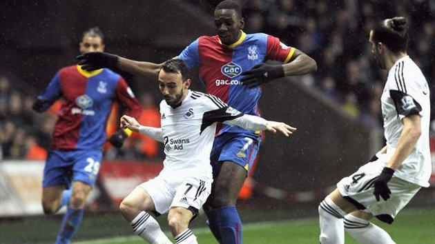2014Swansea City's Leon Britton (C, front) is challenged by Crystal Palace's Yannick Bolasie during their English Premier League soccer match at the L...