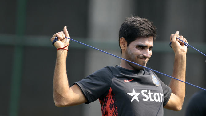 India's Bhuvneshwar Kumar stretches during a practice session ahead of the Asia Cup tournament in Dhaka, Bangladesh, Monday, Feb. 24, 2014. Pakistan plays Sri Lanka in the opening match of the five nation one day cricket event that begins Tuesday. (AP Photo/A.M. Ahad)