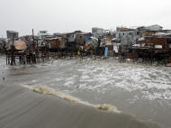 Shanties built along the shore were destroyed by big waves during the height of typhoon Nesat as rains pour due to Typhoon Nalgae Saturday, Oct. 1, 2011 in Navotas town north of Manila, Philippines. A second powerful typhoon this week battered the rain-soaked northern Philippines, adding misery to thousands of people, some of whom still perched on rooftops and reeling under floods alongside several Asian countries. (AP Photo/Pat Roque)