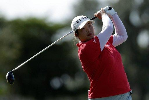 Feng Shanshan of China hits her tee shot on the first hole in the final round of the CME Group Titleholders at the TwinEagles Club on November 18 in Naples, Florida. Feng, who became the first player from mainland China to win a major on the LPGA Tour earlier this year, took a stranglehold on the 500,000 euro Dubai Ladies Masters on Thursday as she opened up a four-shot lead at the halfway stage