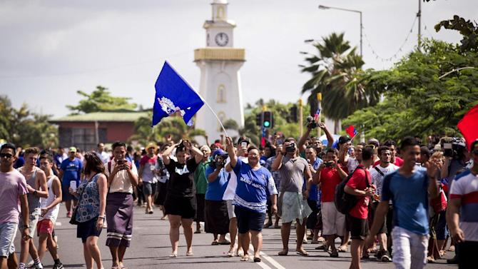 Local people turn out to watch a parade with players from the New Zealand All Blacks and Samoan rugby union teams in Apia, Samoa, Tuesday, June 7, 2015. The All Blacks are making history by playing their first-ever test in the Pacific islands Wednesday. (Dean Purcell/New Zealand Herald via AP) NEW ZEALAND OUT, AUSTRALIA OUT